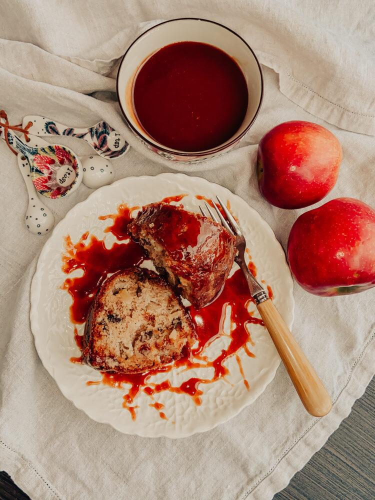 Apple Pecan Bundt Cake Slice with Caramel Rum Sauce